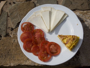 Majorero cheese and tomatoes on Fuerteventura. Photo by Nick Haslam