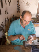 Tinsmith at Ecomuseo de La Alcogida, Fuerteventura. Photo by Nick Haslam