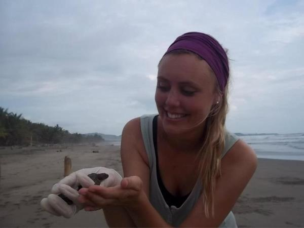 Family volunteering with turtles in Costa Rica