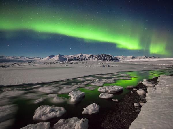 Northern Lights photography vacation in Iceland, coast & ice