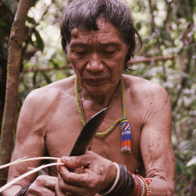 Local tribe with a machete