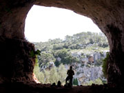 Walker in cave opening, Menorca. Photo by Nick Haslam