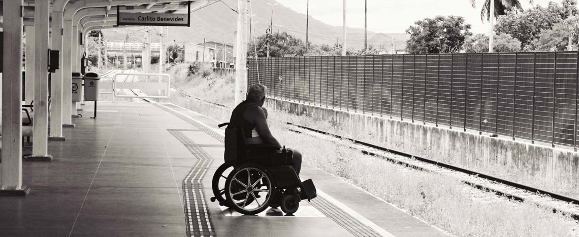 Person waiting for a train in a wheelchair