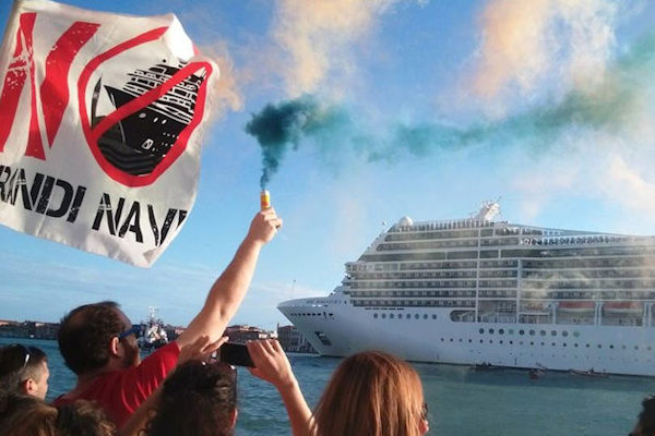 Residents waving a protest flag at a cruise ship