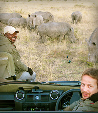 Rhinos & guide, South Africa