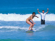 Girl surfing in Western Australia. Photo by Tourism Western Australia