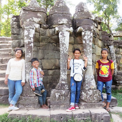 children posing with ruins