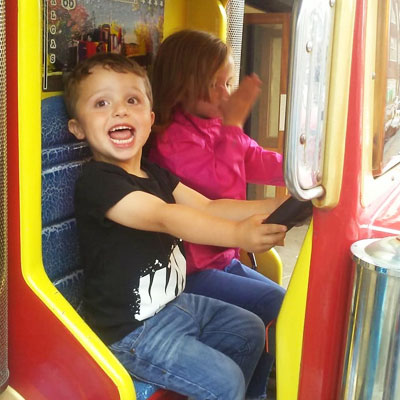 Toddler on amusement ride
