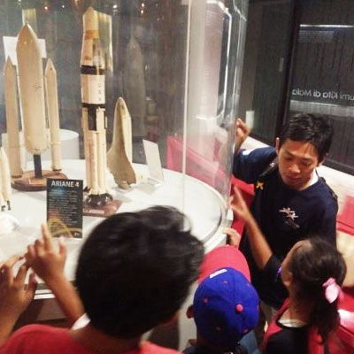 Children looking at rocket