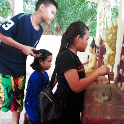 children looking at a shrine