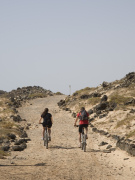 Cyclists on Isla de los Lobos, Fuerteventura. Photo by Nick Haslam