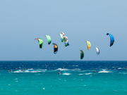 Kitesurfing on Fuerteventura. Photo by Rene Egli Windsurfing And Kitesurfing Pro Center
