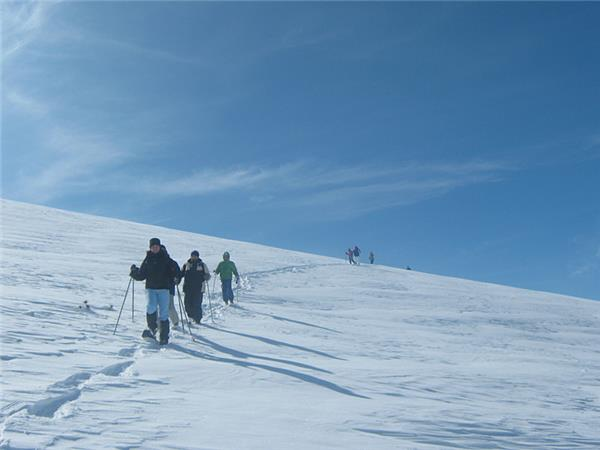 Winter walking and snowshoeing vacation in Italy