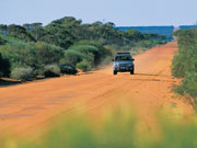 4WD on outback road, Western Australia. Photo by Tourism Western Australia