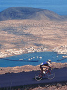 Cycling in Lanzarote with La Graciosa views. Photo by Lanzarote Tourist Board