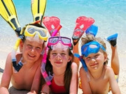 Family beach time, Cayman Islands. Photo by Cayman Islands Tourist Board