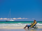 Relaxing at Glenelg beach, South Australia. Photo by South Australia Tourist Board
