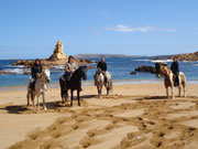Horse riding on a beach in Menorca. Photo from Audax Hotels