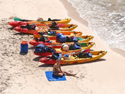 Kayaks on a beach in Menorca. Photo from Audax Hotel