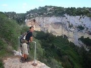 Walker looking out at ravine, Menorca. Photo from Audax Hotel